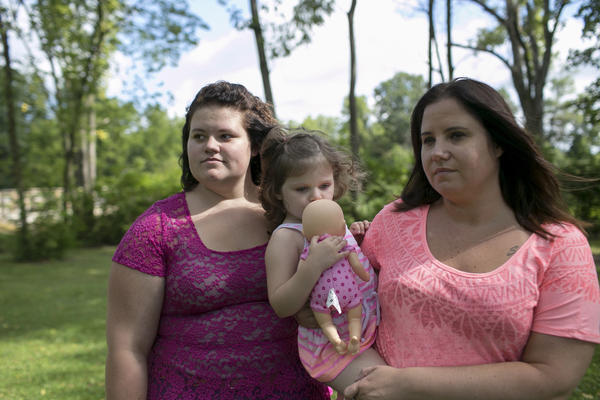 Beth Carey (right) stands in the park with her nieces Jazlen Harden, 3, and Calysta Dildine, 15, in Marion. Chrystina, Beth's twin sister and Jazlen and Calysta's mother, died of a drug overdose in February of 2013.