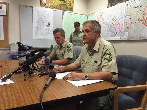 The U.S. Forest Service's John Phipps, left, and Mike Williams give a press conference on the deaths Wednesday of three firefighters near Twisp, Washington.