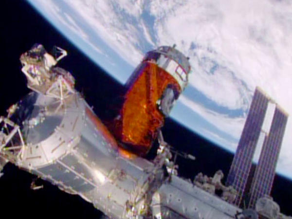 In a photo provided by NASA, a cargo ship from a Japanese company is bolted into place on the International Space Station.