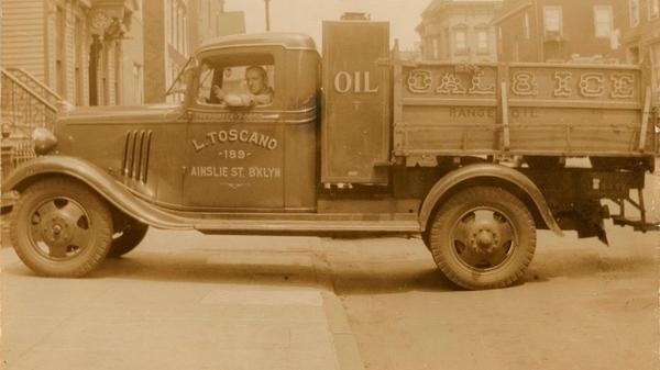 Michael Toscano, father of Brooklyn Public Library patron Vera Toscano, in his company truck, circa 1940.