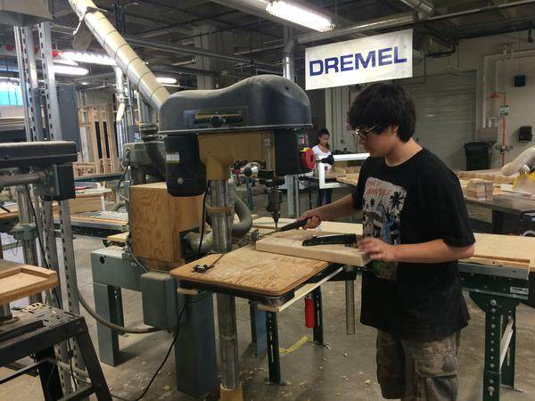 Student Cristian Lopez works in the shop of Providence Career and Technical Academy