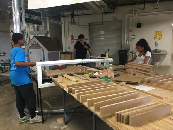 Students in the Hasbro Summer Learning Program use tools in a workshop
