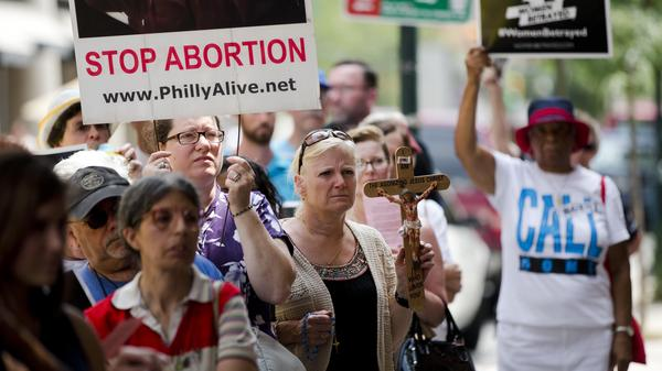 Anti-abortion activists demonstrate near a Planned Parenthood clinic in Philadelphia in late July.