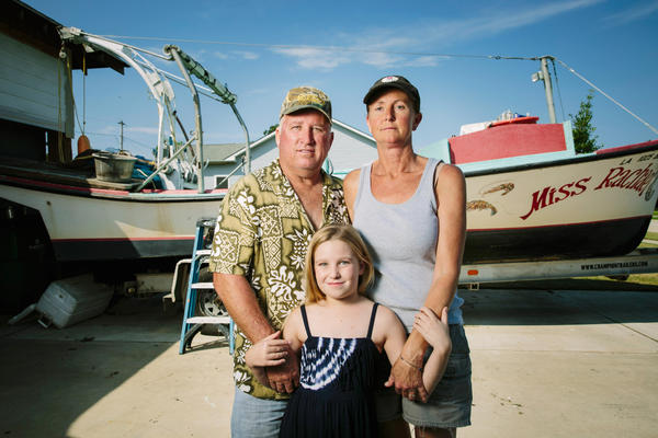 Raymond Gaspard, 54, and Tanya McCrory, 45, with their daughter Grace Gaspard.