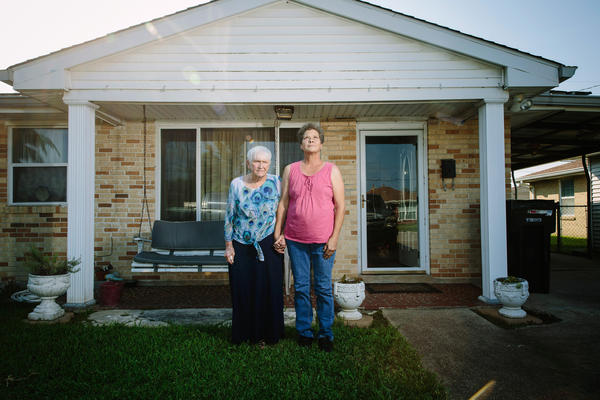 Donna Bordelon (left) and Colleen Bordelon in front of the house where they live on Schnell Drive in Arabi, La.