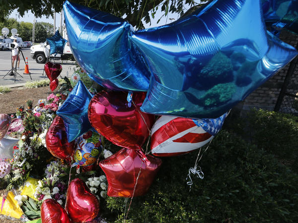 On Thursday, balloons and flowers were in front of the Roanoke, Va., studios of WDBJ-TV. A day before, WDBJ reporter Alison Parker and WDBJ photojournalist Adam Ward were killed during a live broadcast.