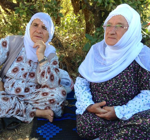 """Sakine Arat, right, and Mayrem Bulut are Kurdish mothers camping out between Turkish amry forces and the Kurdish PKK militants, in hopes of preventing clashes. """"Mothers on both sides should be doing this,"""" says Arat, 80."""