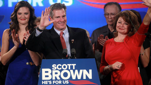 Republican Scott Brown (center) waves to the crowd at the conclusion of his Massachusetts Senate race concession speech Nov. 6 as his daughter Ayla Brown (left) and wife Gail Huff applaud.