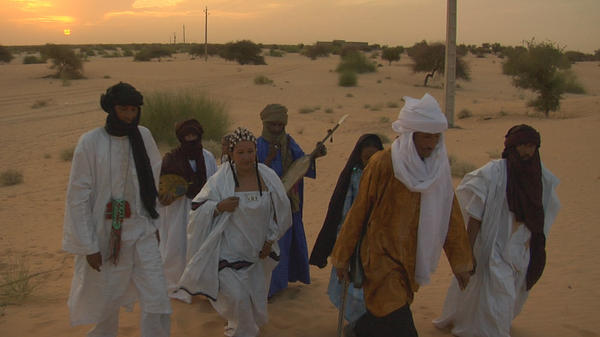 Members of the Tuareg band Tartit at Mali's Festival of the Desert in 2011.