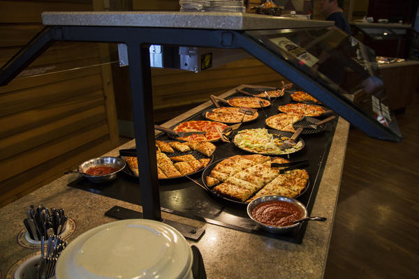 """Pizza Ranch touts its pizza and chicken options, seen here at the Fort Dodge location that opened last year. The company's vision statement is """"to glorify God by positively impacting the world."""""""