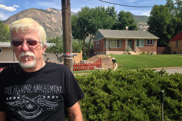 Michael Stewart stands across the street from the house where his late son Matthew David Stewart used to live in Ogden, Utah. It was raided by the local drug task force in January 2012, and an agent died in the crossfire, igniting a statewide controversy over the use of police tactical teams in drug cases.