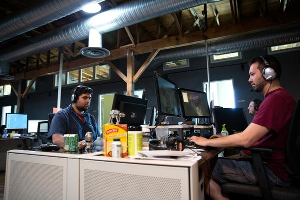 Naveen Nattam (left) and Sean Riley play games during their lunch break at Twisted Pixel, a video game company in Austin.