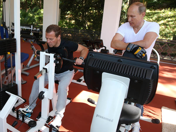 Russian President Vladimir Putin wore a white T-shirt and Prime Minister Dmitry Medvedev wore black to exercise during their meeting at the Black Sea resort of Sochi.