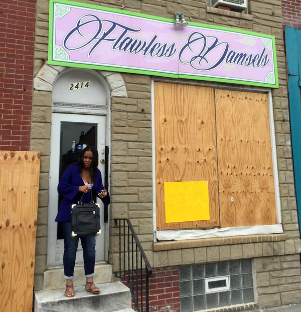 Flawless Damsels was boarded up (shown here in June) after having been looted in riots following the police-custody death of Freddie Gray.