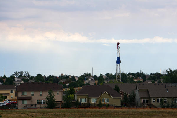 A drill rig seen nestled in the greenspace between housing developments in Frederick, Colo., pictured here in August 2013.