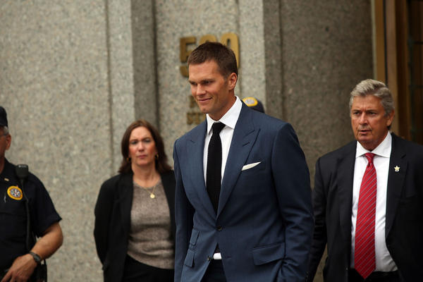 Quarterback Tom Brady of the New England Patriots leaves federal court after contesting his four game suspension with the NFL on August 31, 2015 in New York City. U.S. District Judge Richard Berman had required NFL commissioner Roger Goodell and Brady to be present in court when the NFL and NFL Players Association reconvened their dispute over Brady's four-game Deflategate suspension. The two sides failed to reach an agreement to their seven-month standoff. (Spencer Platt/Getty Images)
