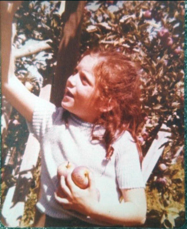 Author Jennifer Jordan at an apple farm in the Central coast of California circa 1976.