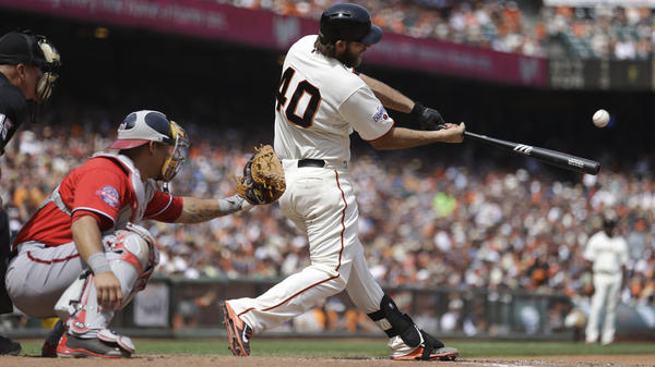 San Francisco Giants pitcher Madison Bumgarner hits a home run against the Washington Nationals.