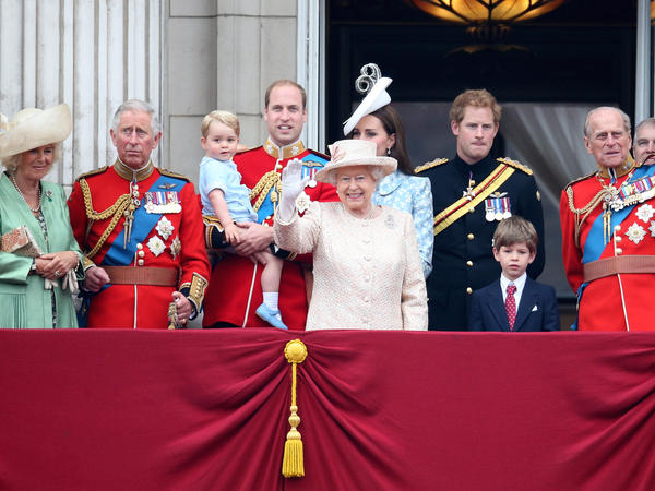 Queen Elizabeth II and royal family members watch from a balcony at Buckingham Palace during her annual birthday parade in June.