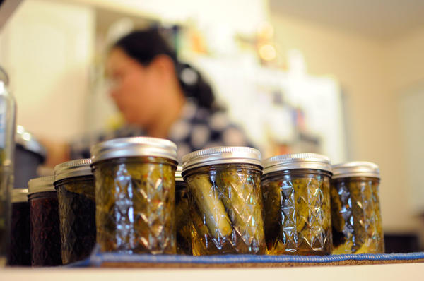 Cucumbers canned to be pickled in Mifsud's kitchen.