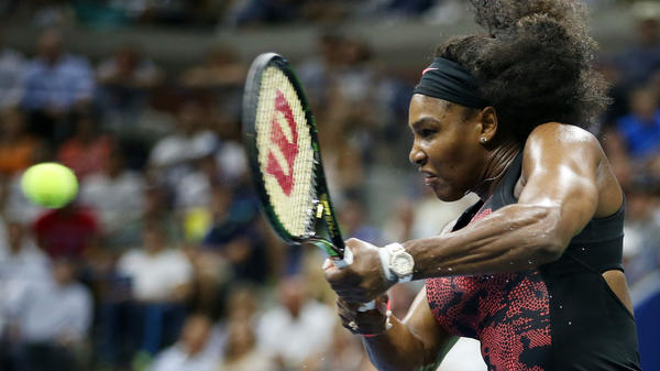 Serena Williams returns a shot to Venus Williams during Tuesday's quarterfinals match of the 2015 U.S. Open in New York City.