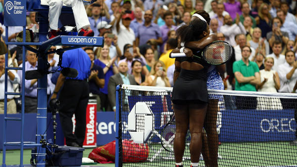 Serena Williams (left) hugs her older sister Venus Williams after defeating her Tuesday night at the U.S. Open, advancing to the semifinals.