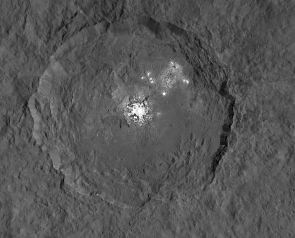 The Occator crater on the dwarf planet Ceres holds bright spots that are unlike any other area on the planet's surface, NASA says. This image's resolution is around 450 feet per pixel.