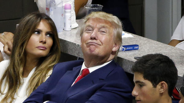 "Donald Trump, seen sitting with his wife, Melania, at the U.S. Open Tennis Championships. He landed in controversy again after he was quoted by Rolling Stone mocking Carly Fiorina and her ""face."""