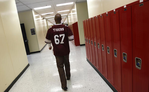 Walter H. Dyett High School principal Charles Campbell tours the school in Chicago in 2012. The bipartisan education reform movement sweeping the nation calls for rating schools by their students' test scores and then taking drastic steps to overhaul the worst performers by firing the teachers, turning the schools over to private management or shutting them down altogether.