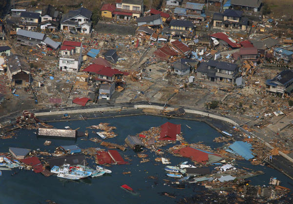 <p>Wrecked ships, houses and debris float in the sea in Kesennuma, Miyagi Prefecture, Sunday, March 13, 2011 after Japan's biggest recorded earthquake hit its eastern coast.</p>