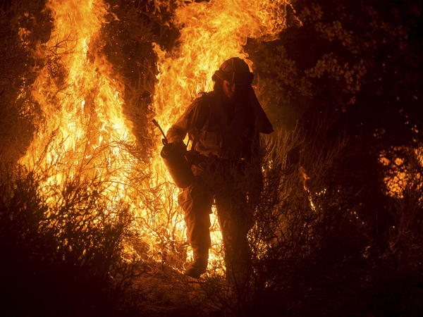 A firefighter lights a backfire while battling the Butte fire near San Andreas, Calif., on Saturday. The Butte fire has destroyed 86 homes and 51 outbuildings in rural Amador and Calaveras counties, where it covers an estimated 65,000 acres.