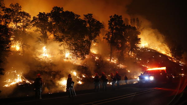 Firefighters monitor a backfire as they battle the Valley Fire on Sunday, near Middletown, Calif. The fast-moving fire has consumed 50,000 acres after growing 40,000 acres in 12 hours.