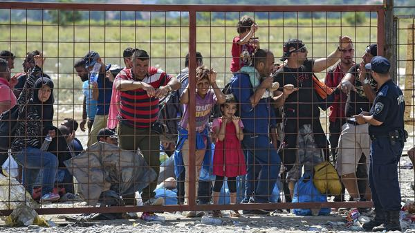 Migrants wait for permission to enter a registration camp near the town of Gevgelija, Macedonia, on Monday.