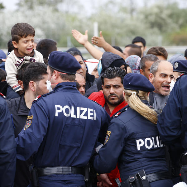 Police attempt to maintain order as migrants try to leave the border crossing in Nickelsdorf, Austria.