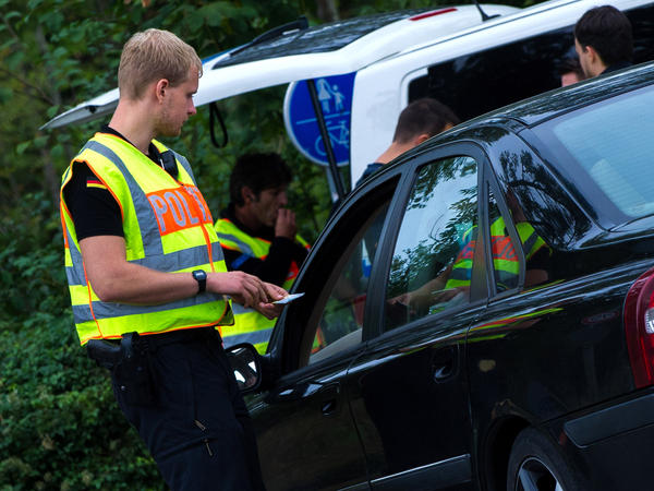 German police officers check vehicles on the border between Austria and Germany near Salzburg, Austria.