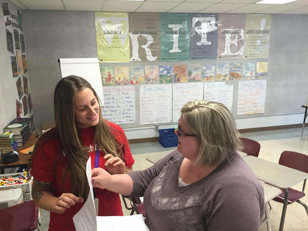 Pasco High School English teachers Amber Wilcox and Tiffany Owona went from their union's contract ratification vote to set up Wilcox's classroom Monday.