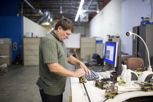 Taxi 2000 is a Minneapolis firm developing the SkyWeb Express system, a point-to-point personal rapid transit system. Here, company CEO Mike Lester works in the company's warehouse in Fridley, Minn.