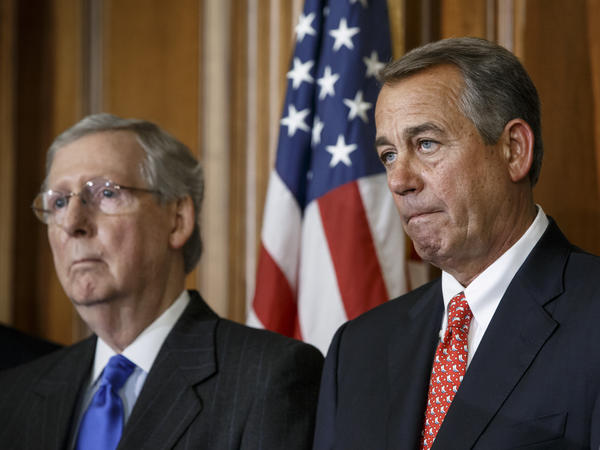 House Speaker John Boehner of Ohio (right) and Senate Majority Leader Mitch McConnell of Kentucky have two weeks to negotiate a plan with congressional Democrats to avert a government shutdown.