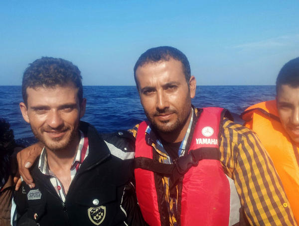 Omar (center) and Alhees (left) traveled by raft from Izmir, Turkey, to Lesbos, Greece.