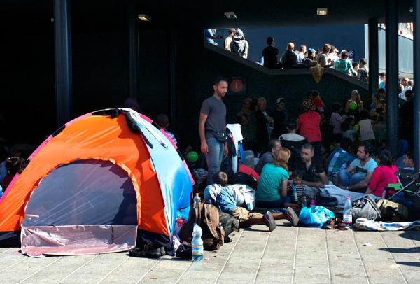 Families camp outside Keleti station in Budapest after the Hungarian government prevented them from traveling.