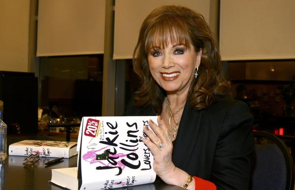 Jackie Collins poses at an appearance at Barnes & Noble to sign her book <em>Lovers And Players</em> in 2006. The author has died at the age of 77.
