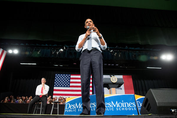 President Barack Obama, and Secretary of Education Arne Duncan, left, discuss college access and affordability at North High School in Des Moines.
