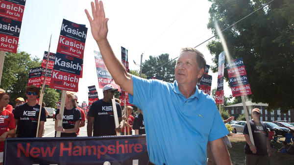Republican presidential candidate John Kasich greets supporters at the Labor Day parade in Milford, N.H., earlier this month.
