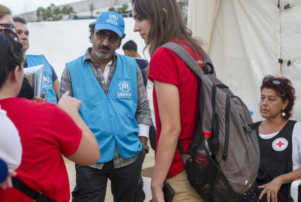Chobani founder and CEO Hamdi Ulukaya, on the Greek island of Lesbos in September, meeting refugees and humanitarian aid workers there. The Office of the United Nations High Commissioner on Refugees has named Ulukaya an Eminent Advocate on the crisis in Europe. (UNHCR)