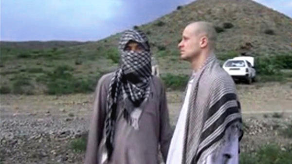 Bergdahl (right) stands with a Taliban fighter in eastern Afghanistan, in this image taken from video obtained from Voice Of Jihad Website. Bergdahl was held captive for five years before his release last year.