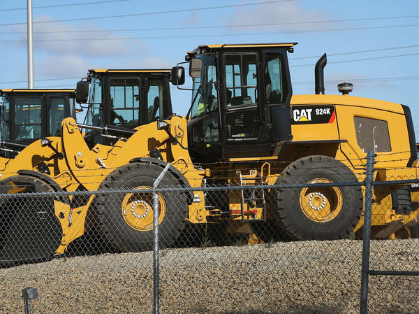 Capterpillar says it plans to lay off up to 10,000 workers, with many of those cuts coming in Illinois, amid a slide in equipment orders.