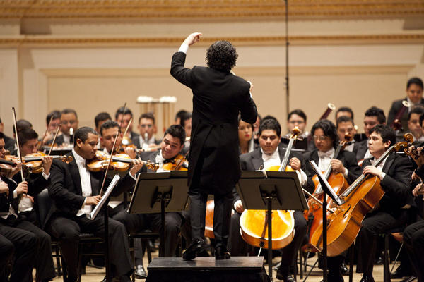 Gustavo Dudamel's musical charisma is felt regularly on at least two continents. He has led the Simón Bolívar Symphony of Venezuela since he was a teenager, and he is now in his fourth season as the music director of the Los Angeles Philharmonic.
