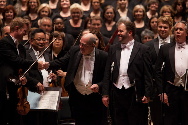 Moments before the music begins, Robert Spano greets the Atlanta Symphony Concertmaster David Coucheron (left) and soloists, tenor Thomas Cooley and baritone Stephen Powell (right).
