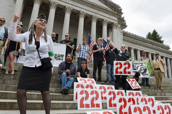 Army veteran Catharine 'Cat' Jeter speaks outside the Legislative Building in Olympia, Washington in July. The rally called attention to veterans suicide and promoted medical marijuana to treat PTSD.