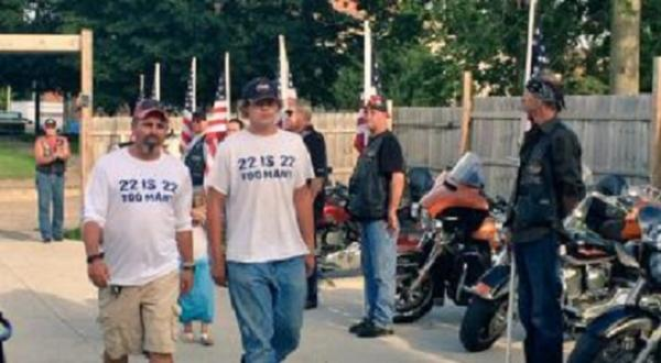 Ex-Marine Toby Flaget (left) arrives in Clinton, Iowa as part of his walk across the nation to bring awareness to veteran suicide.